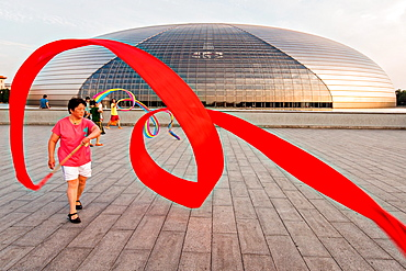 Women practice ribbon dancing at the National Centre for Performing Arts park in Beijing, China