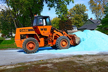 Equipment moving salt stockpile in preparation for winter snowstorms