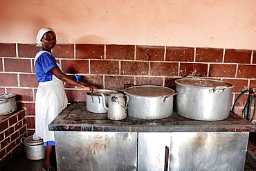 Woman cooking in a school, Maputo, Mozambique, Africa
