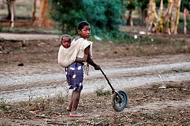 Child with his brother and a self-made toy, Chalucuane, Mozambique. Child with his brother and a self-made toy  Mozambique