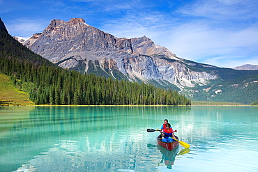 Tourists relaxing on a boat at Emerald Lake, Yoho National Park, Alberta, Canada