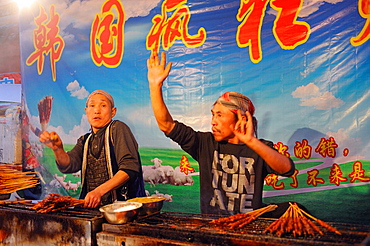 China, Sichuan, Chengdu, Wenshu temple district, Skewer makers swinging with dance music !