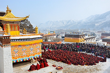 China, Gansu, Amdo, Xiahe, Monastery of Labrang Labuleng Si, Losar New Year festival, Monks and devotees in prayer