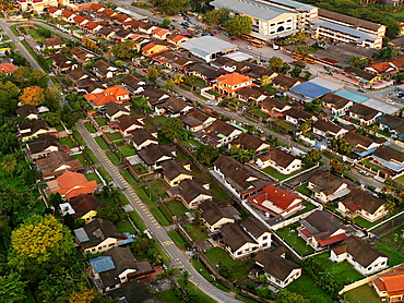 Aerial view of housing developments at dusk