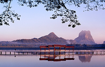 A serene lake in Hpa An with Mount Zwekabin in the background, Kayin state, Myanmar