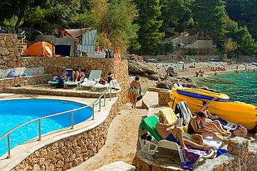 Tourists on Ponta campsite beach in Mokalo village, Peljesac Peninsula, Croatia