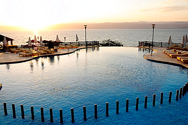 Swimming pool at sunset, Kempinski Hotel, Dead Sea, Jordan, Middle East.