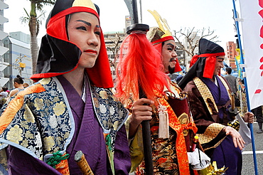 Naha, Okinawa, Japan, leaders of the ëWest Sideí along the Route 58 during the Tug of war Festival, October