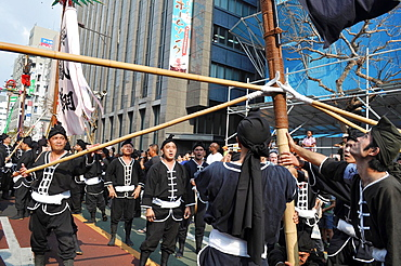 Naha, Okinawa, Japan, Okinawan men along the Route 58 during the Tug of war Festival, October