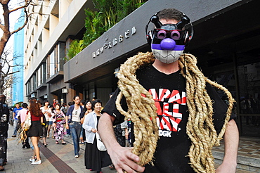 Naha, Okinawa, Japan, weird American soldier in the street during the Tug of war Festival, October
