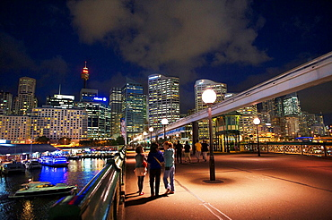 People Walking Across Pyrmont Bridge At Night, Darling Harbour, Sydney