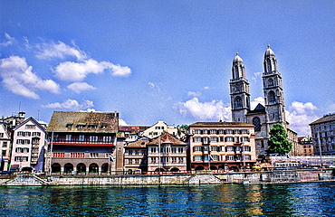Life in Switzerland beautiful twin steeples of the Great cathedral Grossmunster by the river in Zurich Switzerland