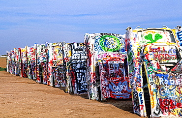 Famous Cadillac Ranch with autos buried in ground off Route 66 in Amarillo Texas USA