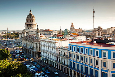 Cuba, Havana, Havana Vieja, the Capitolio Nacional and buildings by the Parque Central, elevated view, dusk
