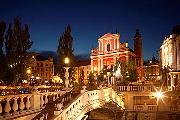Slovenia Ljubljana The Church of Annunciation and the Triple Bridge, over Ljubljanica River.