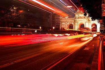 Red lights in Puerta de Alcala, Madrid, Spain