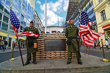 Soldiers At Checkpoint Charlie Historical Site In Berlin, Germany
