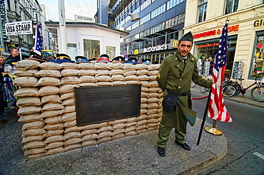 Soldier At Checkpoint Charlie Historical Site In Berlin, Germany