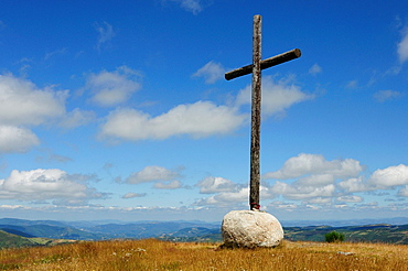 Pilgrim¥s cross in O Cebreiro, Galicia, traditionally covered with crevice-embeded coins by pilgrims on the way to Compostela