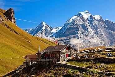 Mountain refuge Rotstock Hut in front of Mt Moench and Mt Jungfrau, Muerren, Bernese Oberland, Switzerland