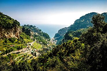 Panoramic view from the high altitude hiking trail between Amalfi and Atrani with typical terraced lemon cultivation sfusato amalfitano