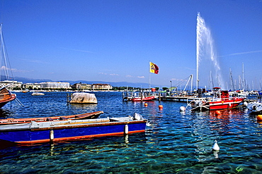 Switzerland Famous Lake Geneva with ship harbor and fountain in capital of Geneva Switzerland