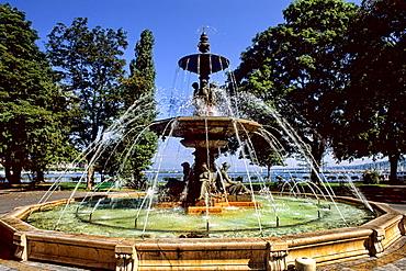 Switzerland Famous Lake Geneva with fountain in park in capital of Geneva Switzerland