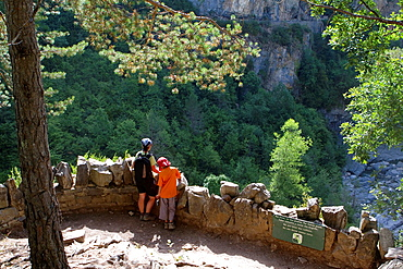 Hikers resting in a viewpoint of Anisclo Valley, canyon belonging to Ordesa y Monte Perdido National Park Pyrenees Fanlo Huesca province Aragon Spain