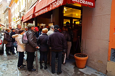 People waiting to get into 2 Torri self service restaurant Quadrilatero central Bologna city Emilia-Romagna region northern Italy Europe
