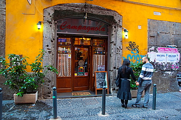 Couple outside Trattoria Campagnola restaurant Via dei Tribunali street centro storico Naples southern Italy Europe