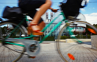 Bicycle passing by the European Court of Human Rights building, Strasbourg, Alsace, France