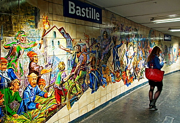 young woman at Bastille subway station in Paris, walls of station are covered with historical colorful mosaics what makes this station very exceptional, Paris, France