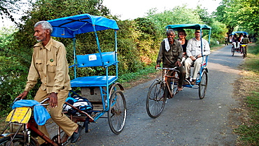 Bird watchers in cyclo richsaw Keoladeo Ghana National Park formerly known as Bharatpur after nearby town Rajasthan India