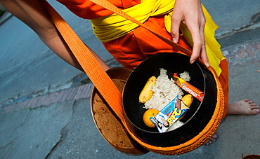 Rice food and drink in monks alms bowl early morning Luang Prabang Laos PDR