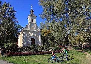 Hungary, Szeged, Lechner Square, St Rosalia Greo-catholic church, park, children,
