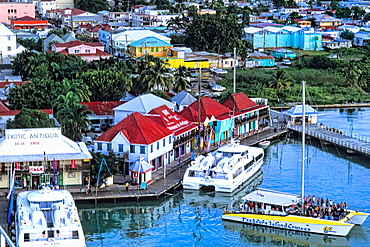 Aerial view of colorful downtown shopping area from cruise ships at beautiful port in St John Antigua