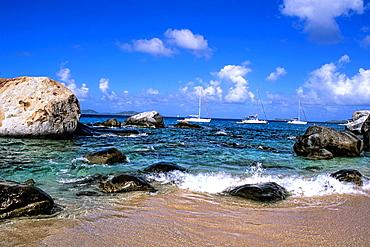 Beautiful rock formation boulder rocks with snorklers in ocean at The Baths of Virgin Gorda in British Virgin Islands
