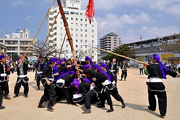 Naha, Okinawa, Japan, men in traditional Okinawan outfit during the Naha Festival October