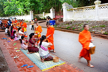 Luang Phabang, Laos-July 22, 2009  Every day very early in the morning, hundreds of monks walk the streets to beg