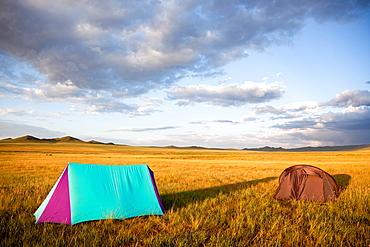 Camping in the Gobi desert at sunset creating shadows lengthened