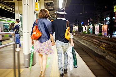 Couple in Harajuku Railway station JR Yamanote Line Harajuku,Tokyo, Japan