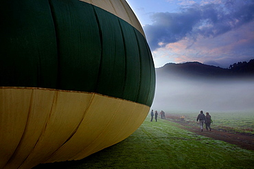 Hot air balloon preparing for flight over Garrotxa Natural Park,Girona province, Catalonia, Spain