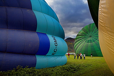 Hot air balloons preparing for flight over Garrotxa Natural Park,Girona province, Catalonia, Spain