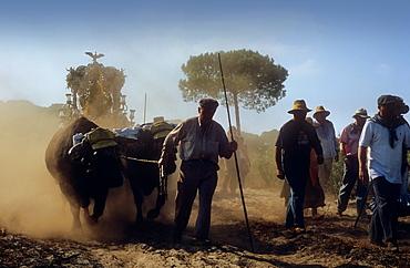 Pilgrims near Cerro del Trigo,Romeria del Rocio, pilgrims on their way through the Donana National Park, pilgrimage of Sanlucar de Barrameda brotherhood, to El Rocio, Almonte, Huelva province, Andalucia