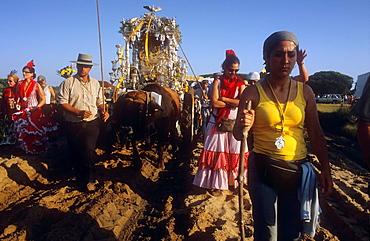 Pilgrims near Donana Palace,Romeria del Rocio, pilgrims on their way through the Donana National Park, pilgrimage of Sanlucar de Barrameda brotherhood, to El Rocio, Almonte, Huelva province, Andalucia
