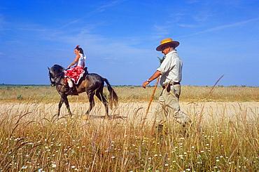 Pilgrims near Rocio village,Romeria del Rocio, pilgrims on their way through the Donana National Park, pilgrimage of Sanlucar de Barrameda brotherhood, to El Rocio, Almonte, Huelva province, Andalucia