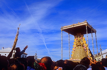 priest screaming wishes and thanks to the virgin,Romeria, pilgrimage, at El Rocio, Blanca Paloma, virgin procession, Almonte, Huelva province, Spain