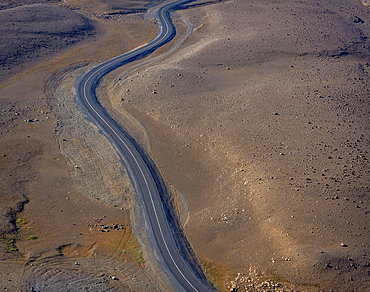 Aerial of deserted road, Northern Iceland  The road is on the way to Dettifoss waterfall which at parts is barren and deserted and often looks like a moonscape