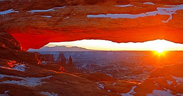 Sunrise and sunbeam at Mesa Arch, Canyonlands National Park, USA