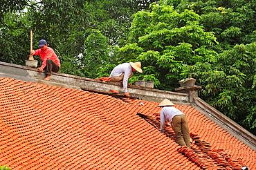 roof repairs at the Temple of Literature, Hanoi, Vietnam